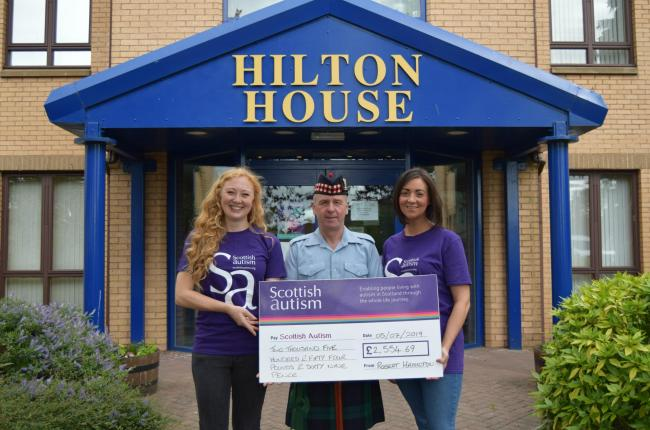 Stacey Galfskiy, Scottish Autism events fundraiser, Sgt Maj Robert Hamilton and autism practiconer Vickie McTaggart with the cheque