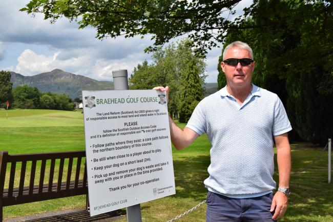 APPEAL: Club secretary David Dick with one of the signs explaining the rules