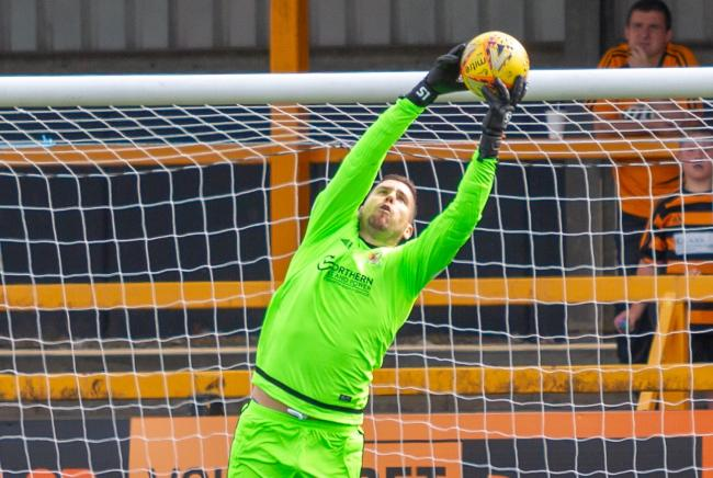 HANDY MAN: Neil Parry in action against Arbroath at the Indodrill on Saturday. Pic by John Howie