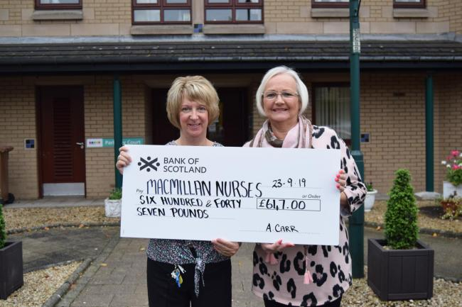 Parkway Court's Mandy Ashbridge and Avril Carr with their cheque for the good cause
