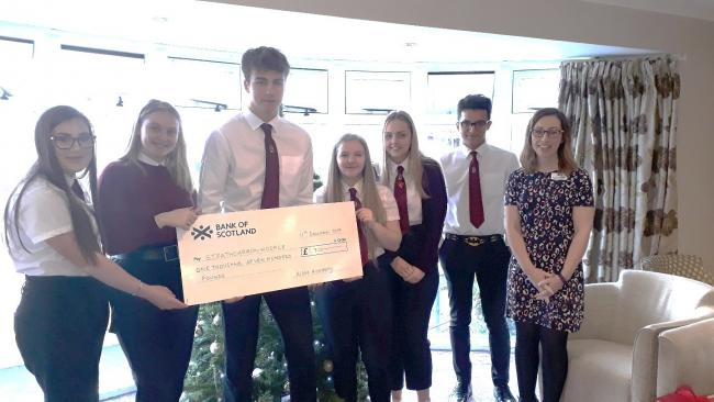 PRESENTATION: Pupils Lucy-Anne Hartley, Toni Philp, head boy Jamie Struthers, Savannah Taylor, Morgan Green and Hasan Akram with Claire Kennedy from Strathcarron Hospice