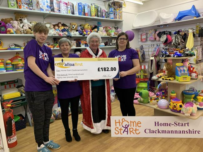 Alloa First's Morag Walsh hands over the cheque to Home-Start Clackmannanshire