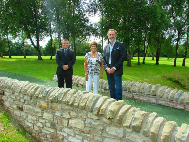 Club captain Andy McDonald, late Mr Doyle's wife Angeline and his son Derek on the bridge when it officially opened last week