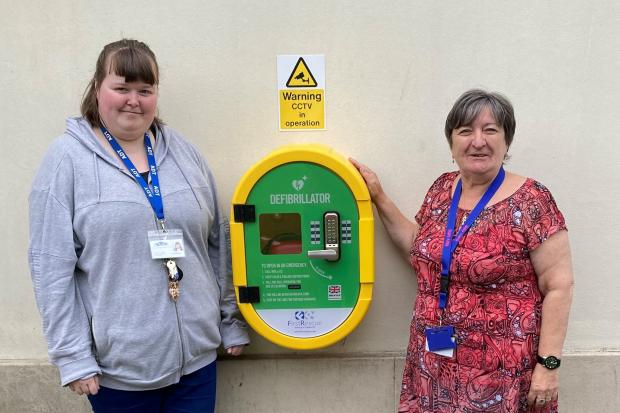 Volunteer Gemma Waghorn and Mary Laing with the device at the Cochrane Hall