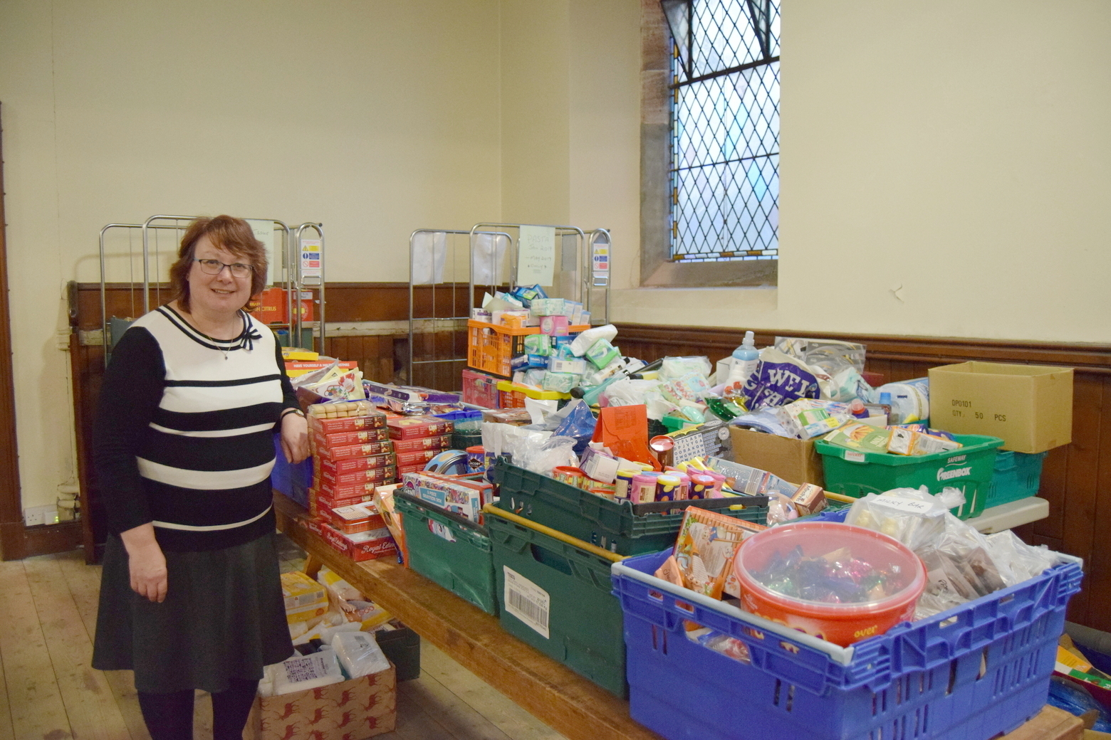 BIG THANKS: Adrienne Hilton with some of the donations handed in to The Gate over the festive period
