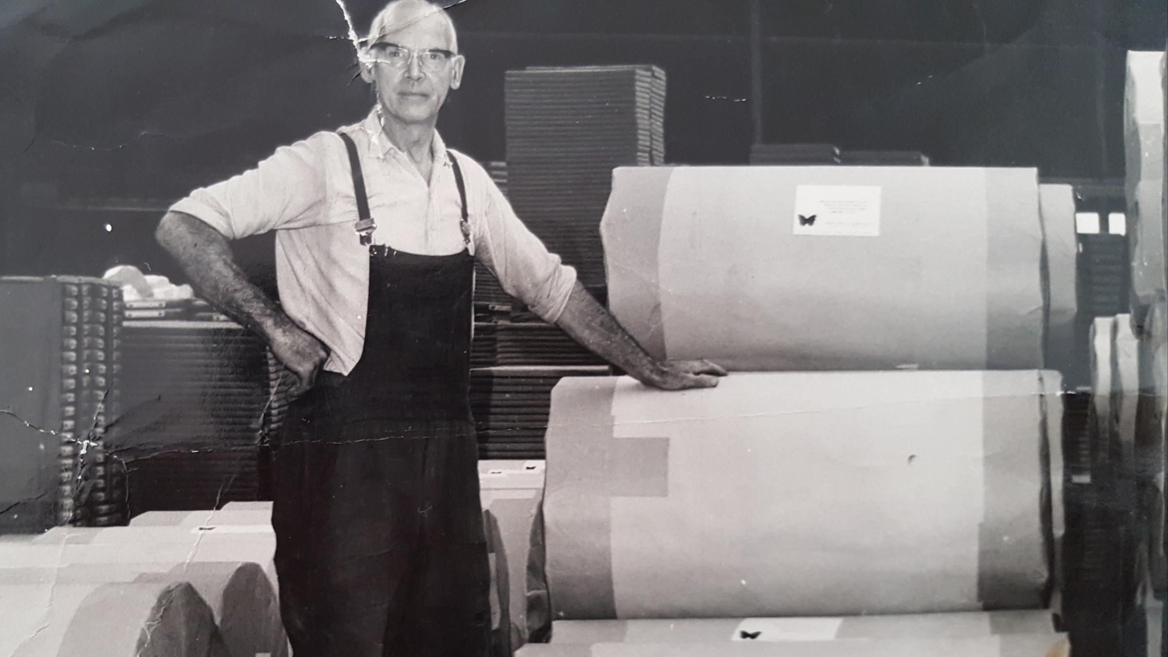 WORK PRIDE: Mill employee David Forsyth with the rolls of paper featuring the butterfly logo. The image is thought to have been takein in the 1960s.