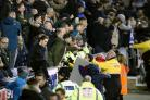 Manchester City fans clash with police and Wigan Athletic fans after the final whistle
