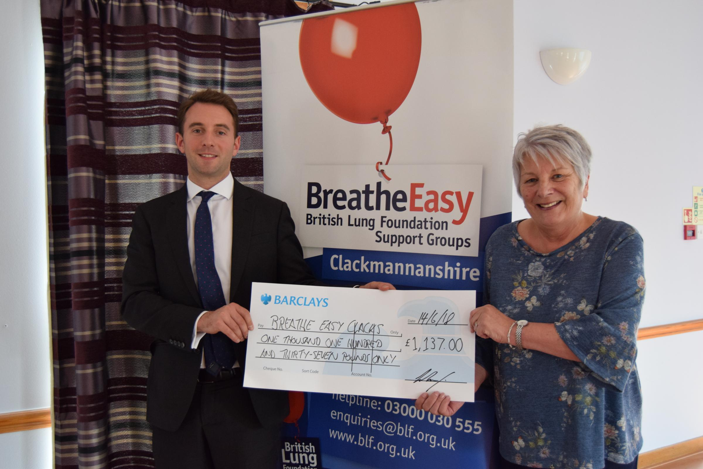 MP Luke Graham presents his cheque to Linda McLeod of Breathe Easy Clackmannanshire - money was raised through sponsorship at the Alloa Half Marathon which he ran twice