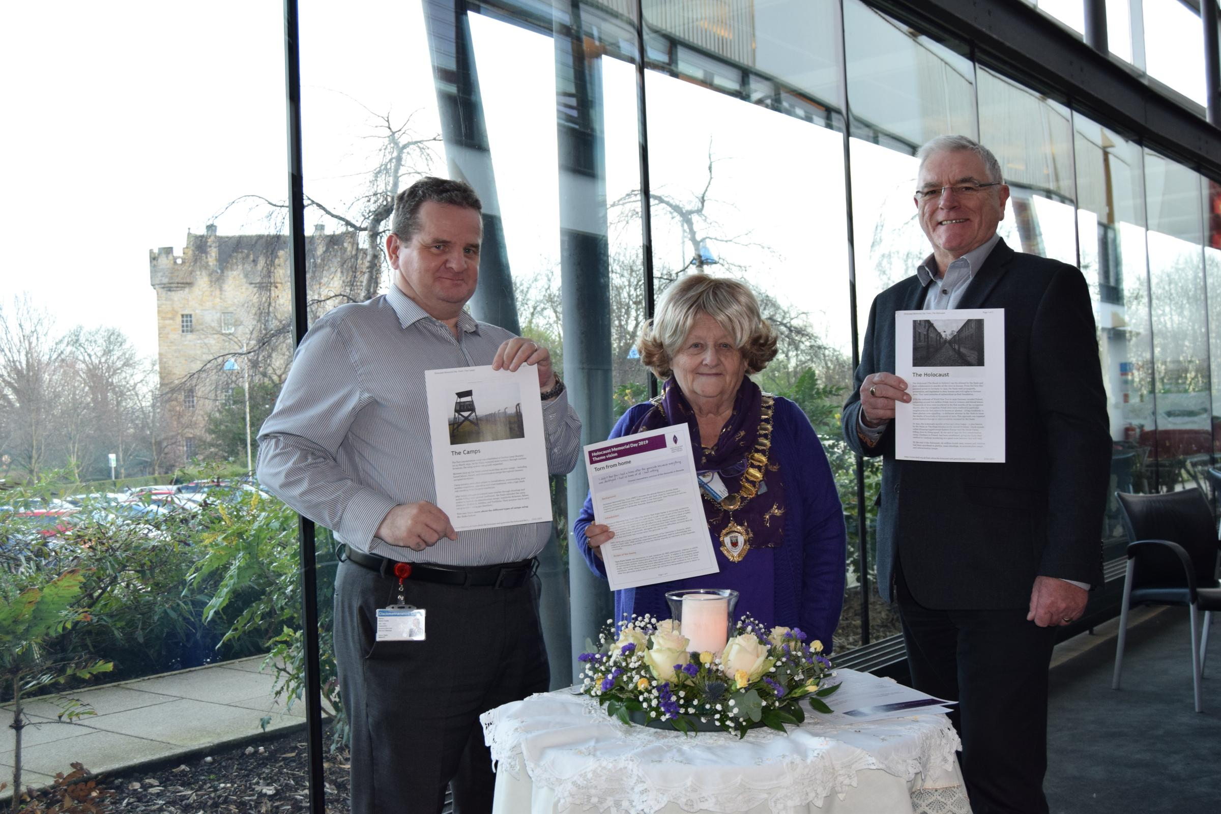 PAYING RESPECTS: Cllr Kenny Earle, Provost Tina Murphy and Cllr Les Sharp mark Holocaust Memorial Day 2019 at Clackmannanshire Council