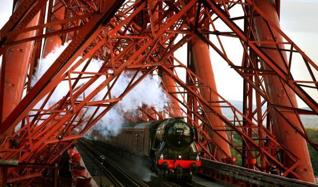 The Flying Scotsman crosses the Forth Bridge.