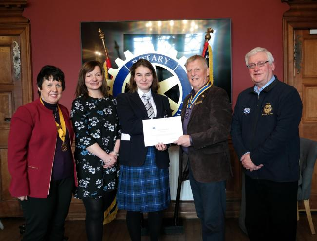 EXPERIENCE: Runa was presented with a certificate from the rotary club upon her return to the UK