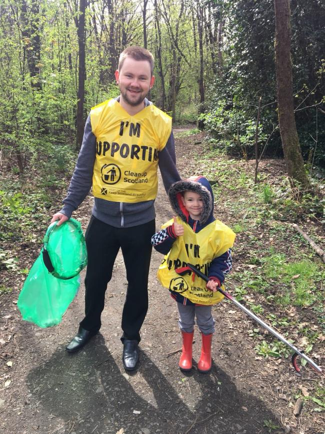 Councillor Darren Lee and his son at the most recent clean-up event with the Delph Pond Forum in Tullibody where he lives