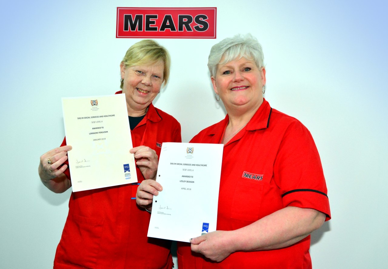 Lorraine Ferguson and Lesley Dickson with their qualifications